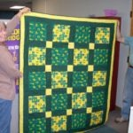 Denise holding the quilt.