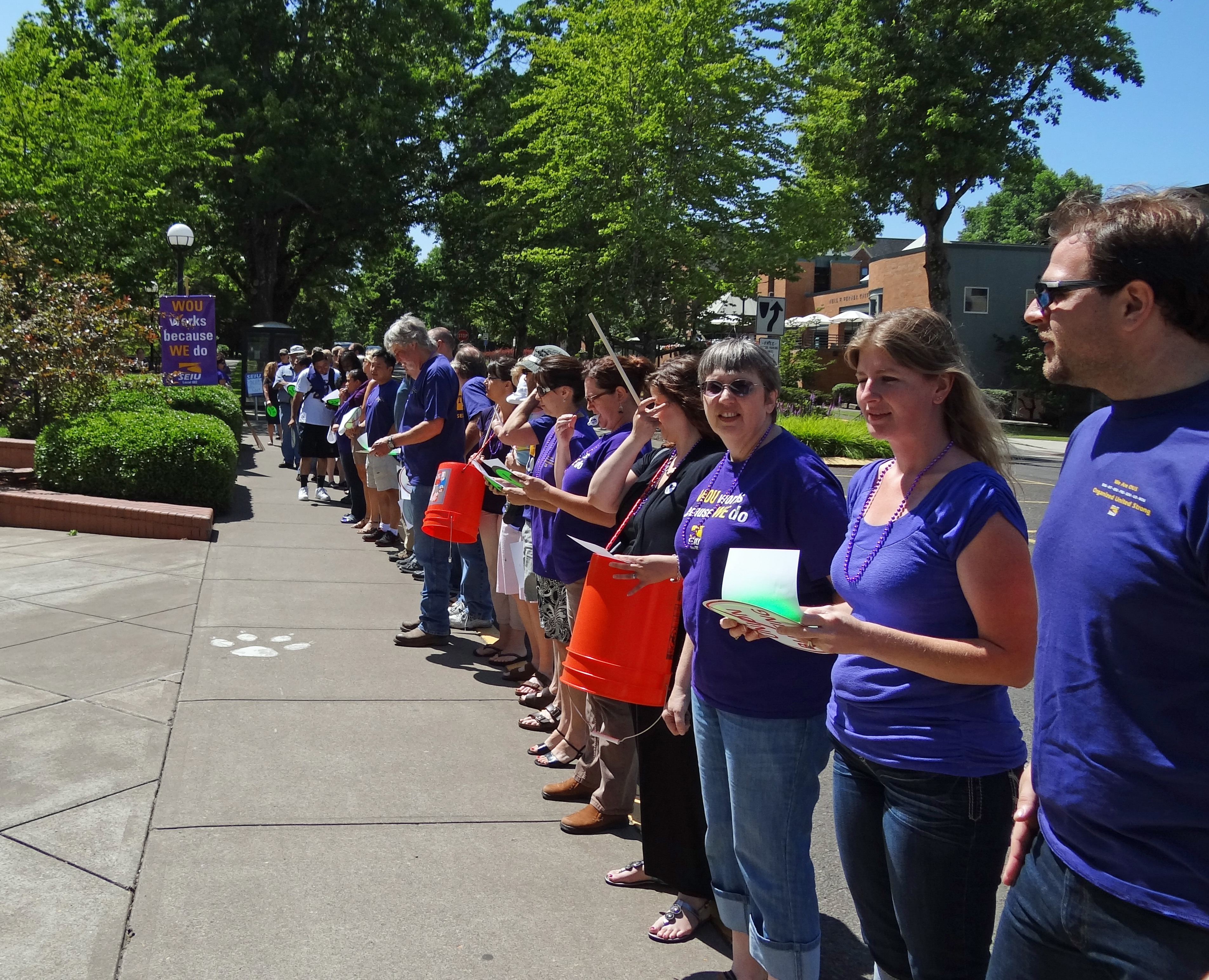 Photo of SEIU members lined up in front of the library