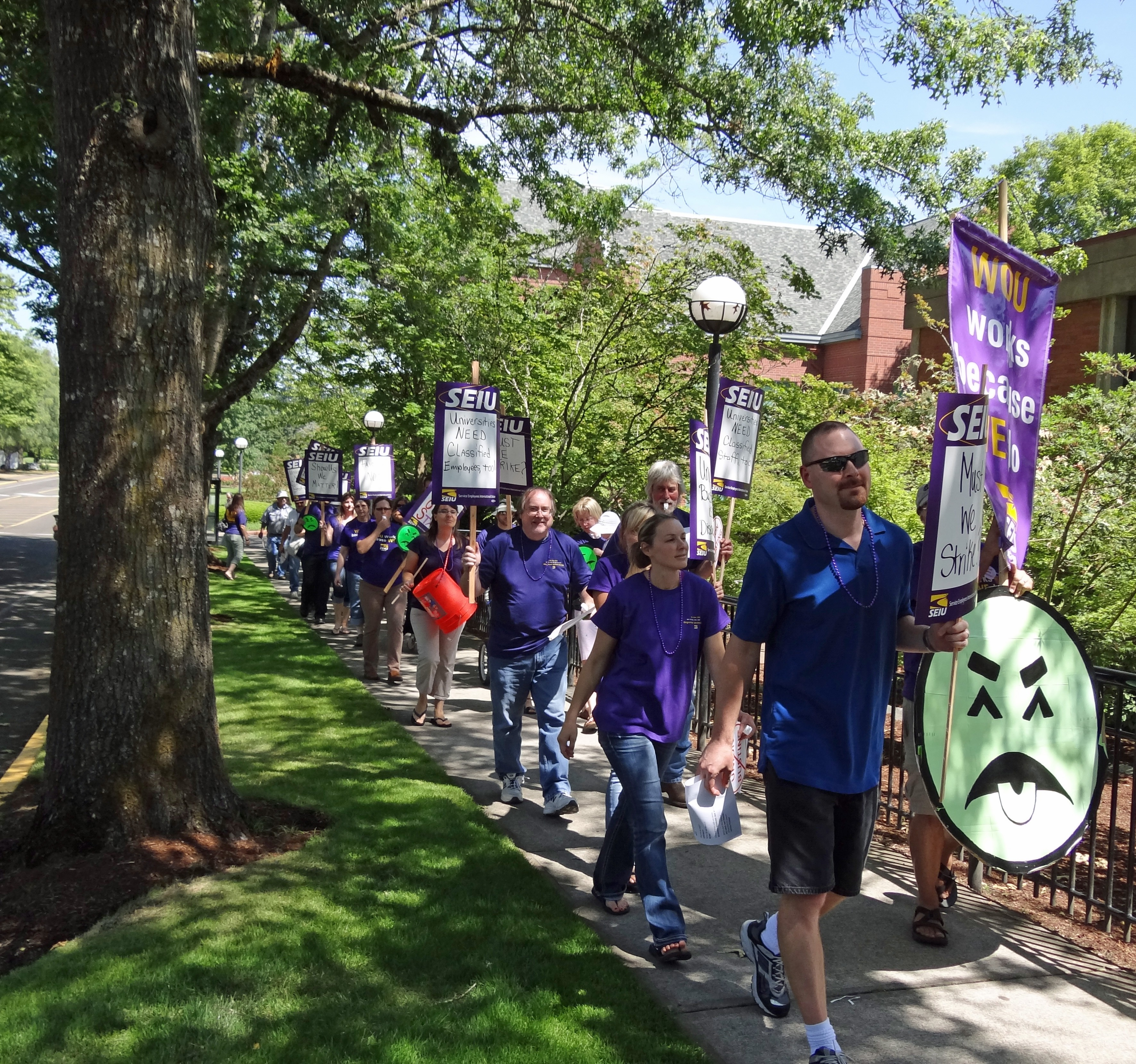 Photo of SEIU members marching off of WOU campus