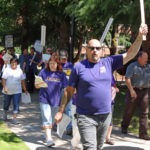 Photo of SEIU member Bob Klem leading the march
