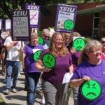 Photo of SEIU member Helen Moore leading march