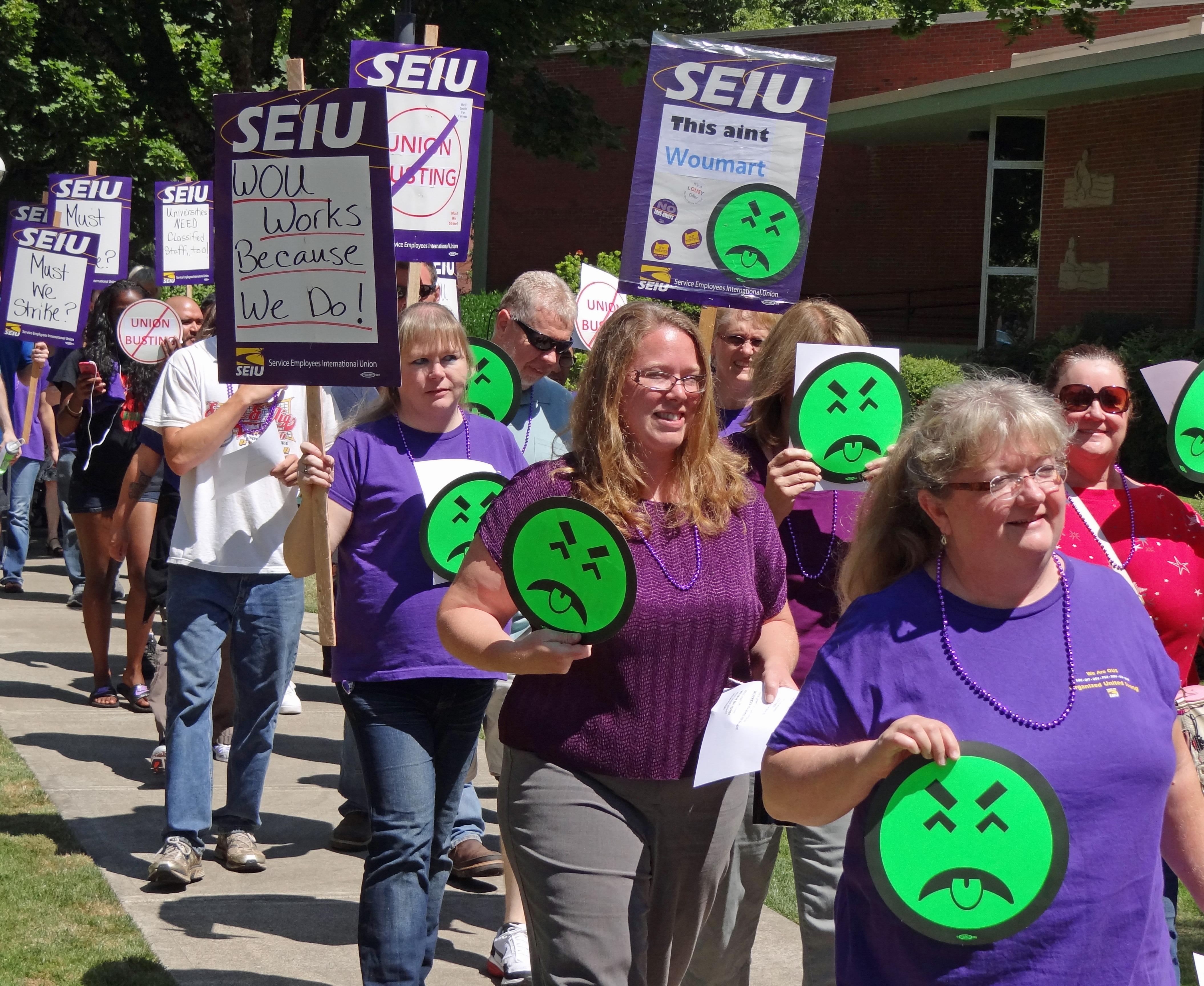 Photo of SEIU member Helen Moore leading march