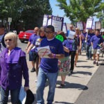 Photo of SEIU members marching down Main Street