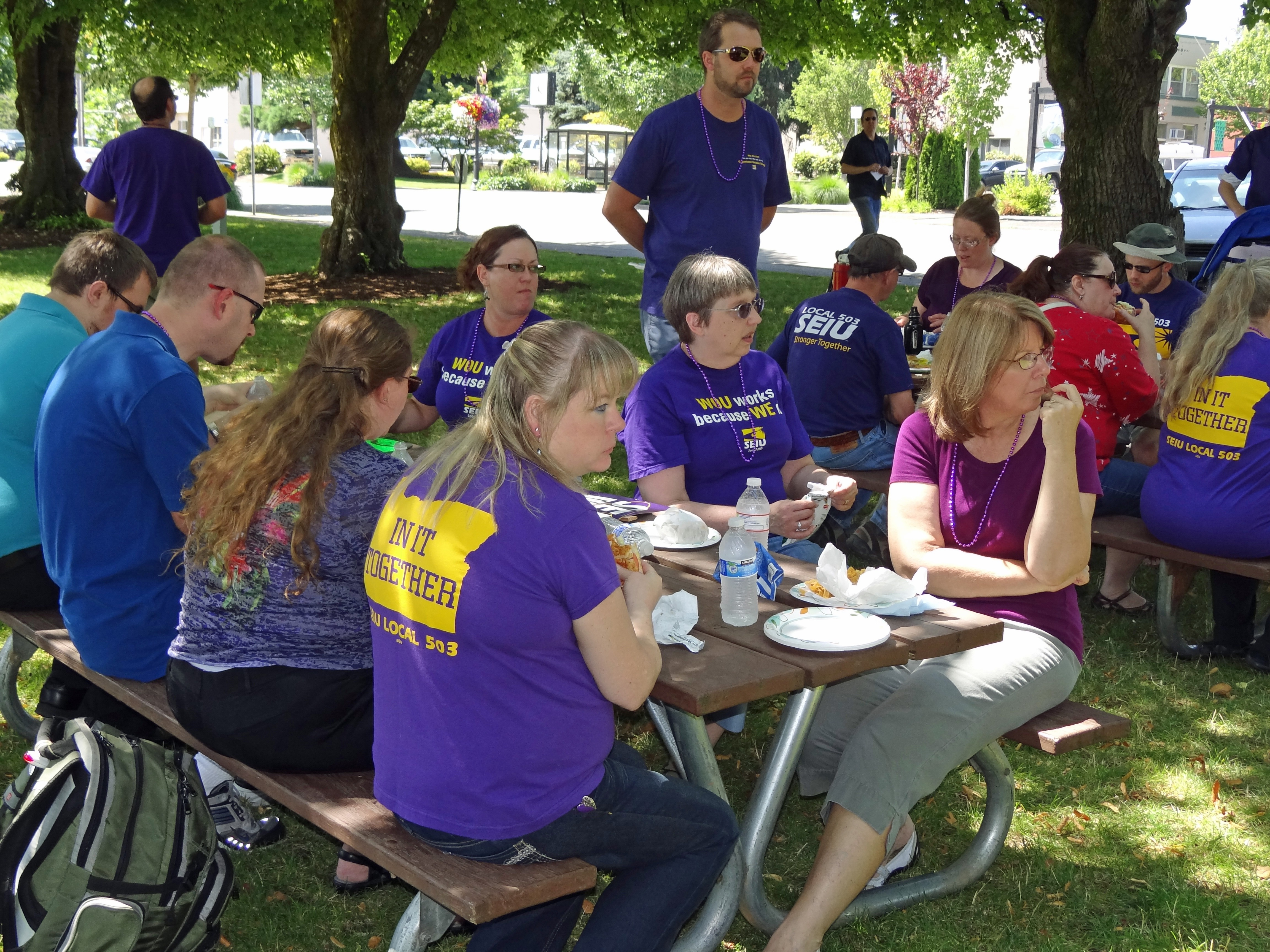 Photo of SEIU members having lunch and listening to updates