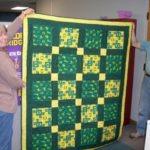 Denise holding the quilt.