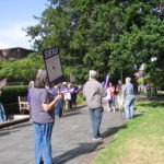 Photo of library employees taking a unity break outside the library.