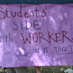 "Close up of sign that says ""students side with workers, in it together!"""