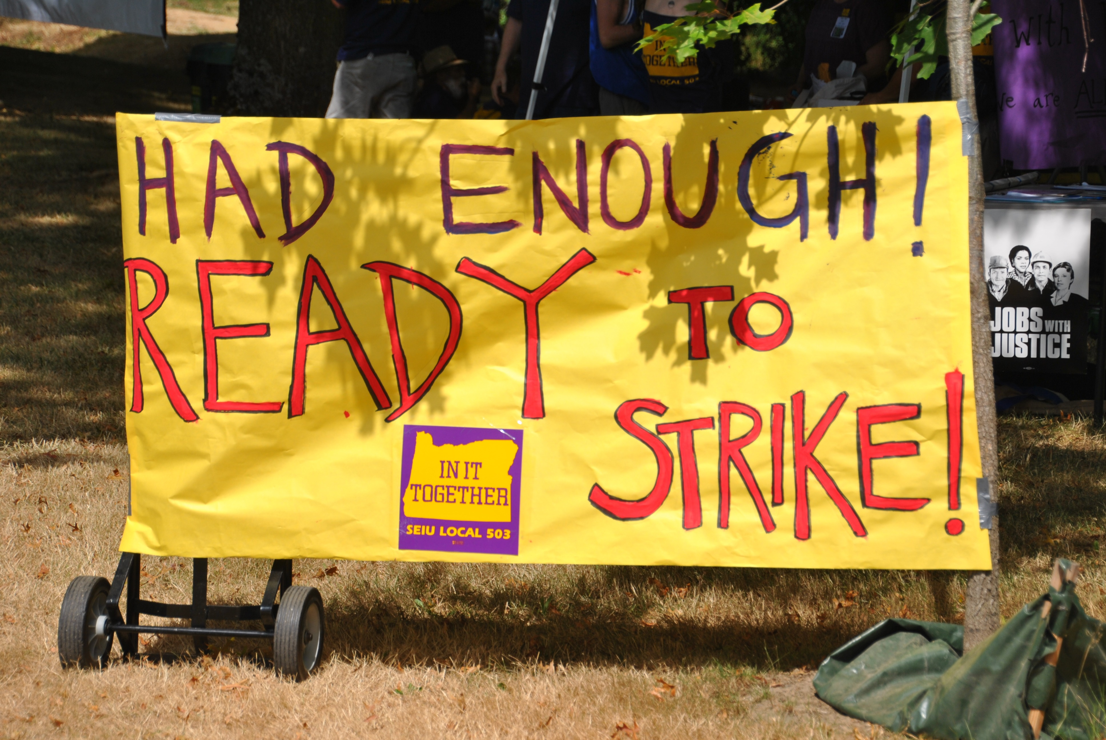 "Picture of sign that says ""had enough! ready to strike!"""