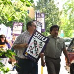 Picture of members marching with picketing signs