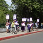 Picture of workers marching on Franklin with picketing signs