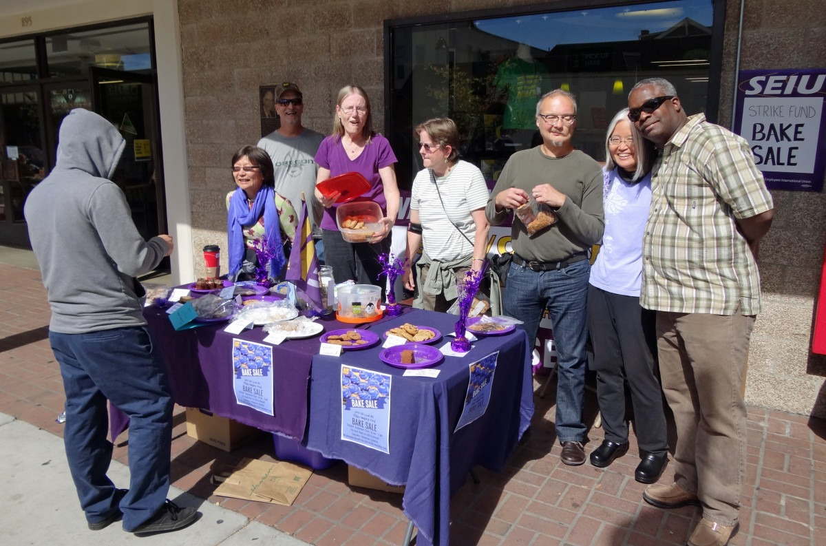 Bake sale photo 1: SEIU members and interested buyer!