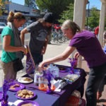 Bake sale photo 3: two community members buying baked goods