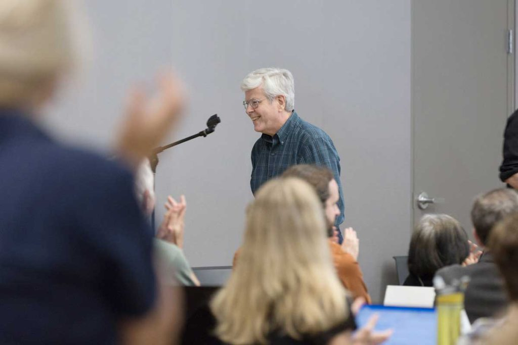 Kurt Willcox is applauded by members of the UO Senate, who voted to award him their annual Classified Staff Leadership Award. It is in honor of a leader that fosters a healthy work environment.
