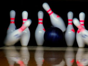 purple bowling pin strikes pins
